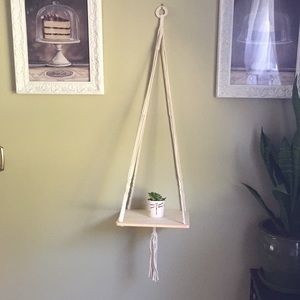 Two macrame hanging wood shelves.